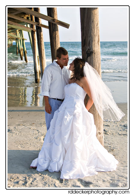 Bride and Groom under the Oceana Fishing Pier, Atlantic Beach, North Carolina