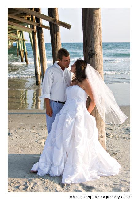 Bride And Groom Under The Oceana Fishing Pier Atlantic Beach North Carolina